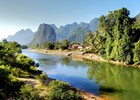 Song river at Vang Vieng - shutterstock_114936529 - Chantal de Bruijne.jpg